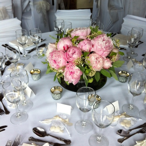 And pillar candles are a romantic addition to your floral centrepieces ...