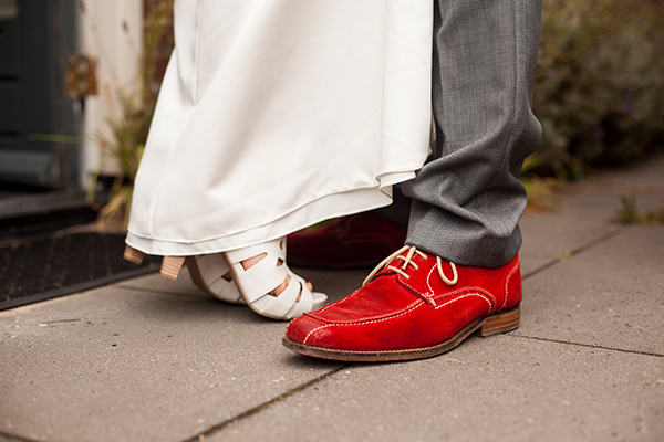 groom red shoes
