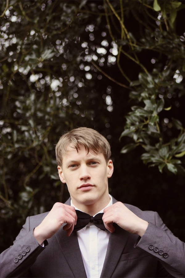 groom black bow tie
