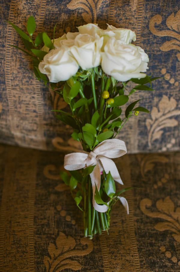 loose white rose bouquet with ribbon