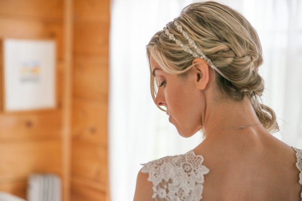 plaited side swept bridal hairstyle
